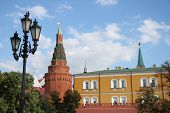 picture of arsenal  - Angle Arsenal tower Arsenalnaya Tower of Kremlin wall over blue cloudy sky - JPG