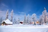 stock photo of nightfall  - Winter landscape with cabin hut at night in Kiruna Sweden at Night with star trail - JPG