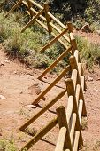 stock photo of split rail fence  - A split rail fence curving across the desert