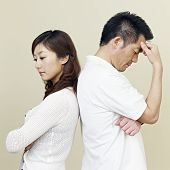 stock photo of cold-war  - young asian husband and wife having relationship difficulties - JPG