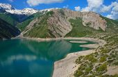 pic of swales  - Amazing mountain lake with beautiful island and high coast in Kyrgyzstan - JPG
