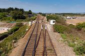 Dawlish Warren railway track Devon England on blue sky summer day