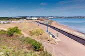 View of Dawlish Warren beach coast and promenade Devon England on blue sky summer day