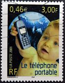 France - Circa 2001: A Stamp Printed In France Shows Baby With A Mobile Phone, Circa 2001