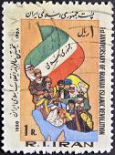 A stamp printed in Iran dedicated to first anniversary of iranian islamic revolution
