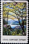 A stamp printed in USA shows Magnolia and Irises by Louis Comfort Tiffany