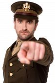 Young Soldier Pointing Towards Camera
