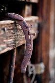 Rusty Horseshoe Hanging In Barn