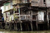Shanty house in Bangkok water canals along the river bank, Thailand