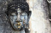 stock photo of stone sculpture  - Head detail of old Buddha statue in the Wat Saphan Hin temple in Sukhothai historic park - JPG