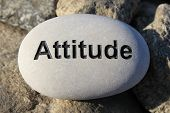 stock photo of reinforcing  - Positive reinforcement word Attitude engrained in a rock - JPG