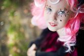 picture of antichrist  - Cute girl with painted eyelashed and pink wig looking at camera - JPG