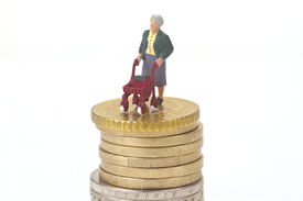 picture of rollator  - Female senior with walking frame and euro coins on white background - JPG