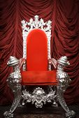 pic of throne  - A red velvet throne with a red velvet backdrop - JPG