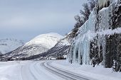 pic of tromso  - Road running through snowy mountains in northern Norway