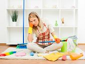 stock photo of boredom  - Portrait of housewife who is fed up of cleaning - JPG