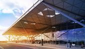 STANSTED AIRPORT, LONDON UK - 23 FEBRUARY 2014: airport building with sun light and sky reflection