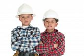 Boys Wearing Construction Hardhats Arms Folded Looking At Camera