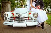 picture of flirt  - wedding couple with old wedding car outdoors - JPG
