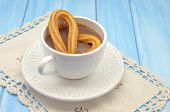pic of churros  - Cup of hot chocolate and several Churros - JPG