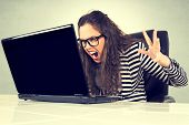 image of adversity humor  - Selective focus on the angry businesswoman screaming - JPG