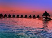 Island in ocean Maldives. Sunset.