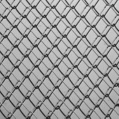 Obsolete Gray Grunge Concrete Closed With Chain Link Fence And Shadows