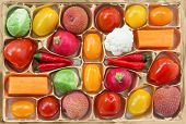 Chocolate box with vegetable and fruit contents