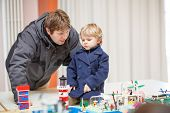 pic of exposition  - Father and little son having fun on toy exposition indoors - JPG