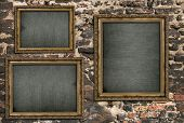 picture of triptych  - Triptych with empty canvas over ruined brick wall - JPG