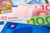 Global Blue, Visa And Mastercard Credit Cards On Euro Banknotes