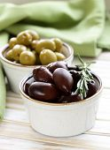 marinated green and black olives (Kalamata) in a ceramic bowl