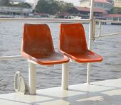 Old Orange Seat In The Boat Sailing