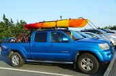 Toyota Tacoma SUV loaded with kayak and bicycles in Acadia National Park
