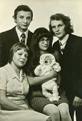 LODZ, POLAND,CIRCA SEVENTIES- vintage photo of parents and godparents with a baby (christening)