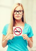 picture of woman with smoking restriction sign .