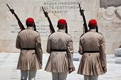 stock photo of evzon  - Evzones are the elite guards of the Greek army and are shown wearing the traditional dress of the Fustanelle - JPG