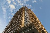 Coquitlam, BC Canada - August 24,  2014 : Brend new high rise building against blue sky in Coquitlam BC Canada.