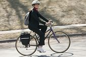 Businesswoman Biking To Work