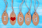 Love tags on wooden background