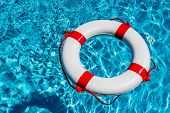 an emergency tire floating in a swimming pool. symbol photo for rescue and crisis management in the