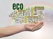 Concept or conceptual abstract green eco or ecology, conservation word cloud text in man hand, rainb