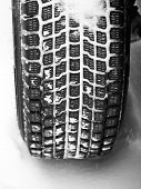 pic of mud pack  - Mud and snow tire tread packed with snow - JPG
