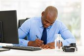 busy afro american businessman working in office