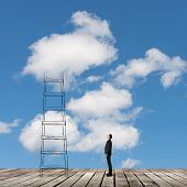 Concept of access to clouds with man and a stair.