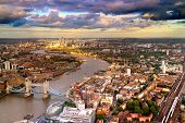 stock photo of canary  - East London Skyline showing Tower Bridge Canary Wharf City Hall and the Thames river - JPG