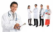 Group of southeast Asian doctors standing isolated on white background.