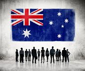 Silhouettes of Business People Looking at the Australian Flag