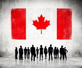 Silhouettes of Business People Looking at the Canadian Flag