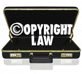 Copyright Law words and c symbol in 3d letters in a black leather briefcase of an attorney or lawyer in an infingement lawsuit against piracy